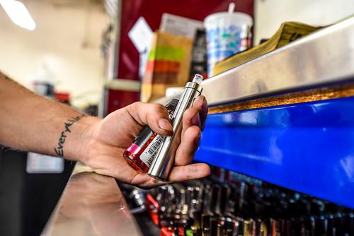 E-Cig Vape Pen and E-Juice Handcheck